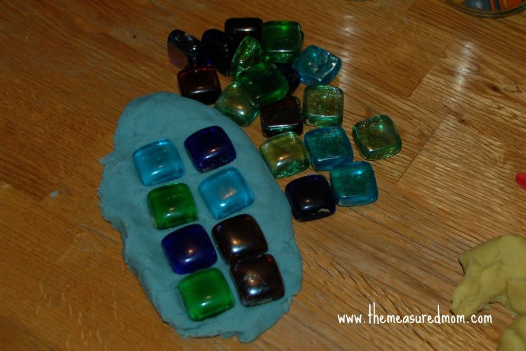 mosaic tiles pressed into playdough