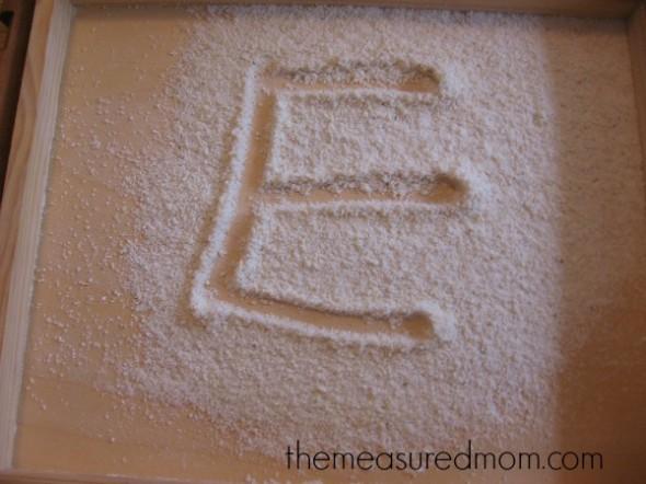 letter E written in cornmeal