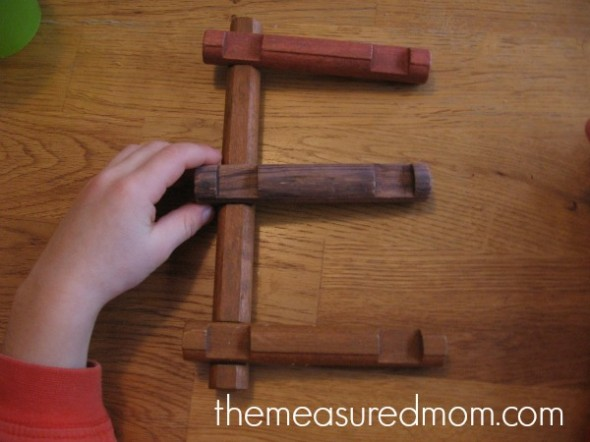 letter E with Lincoln Logs