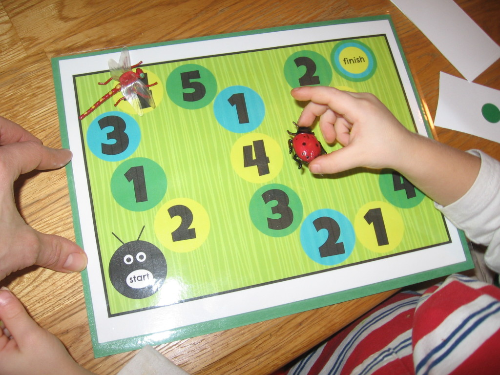 playing the board game 1024x768 Hands on Math for Preschool: The Letter I