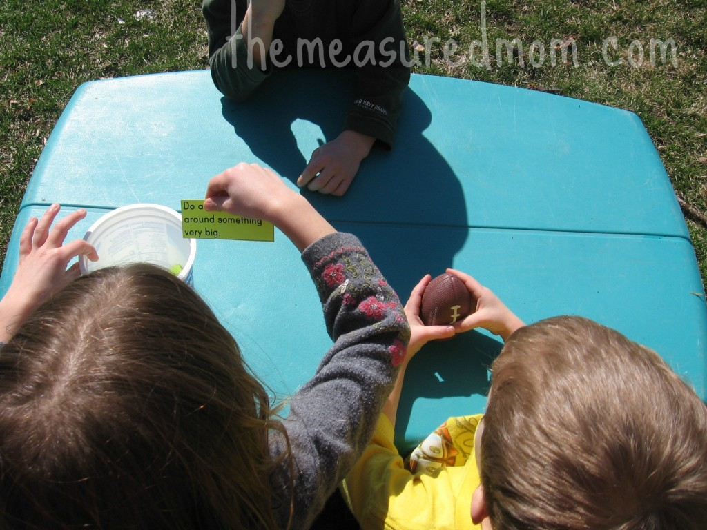 outdoor math game for preschoolers 1 the measured mom1 1024x768 Outdoor Math Game for Preschoolers: Exploring Size (with printable action cards)