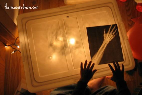 child with X-ray sensory bin