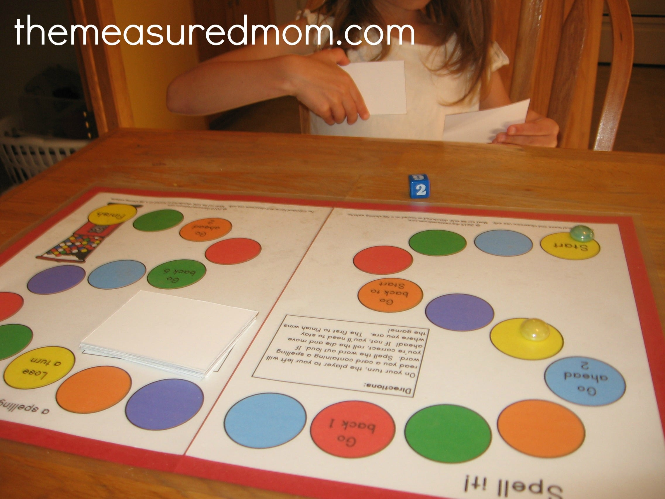 daughter playing spell it game the measured mom Spell it!    a printable spelling game for any word list (K 3)