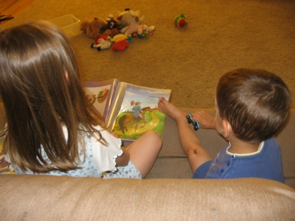 read to sibling 590x442 How to organize summer learning activities for kids