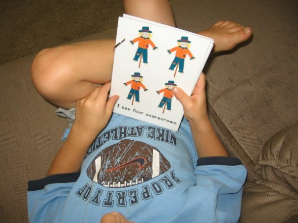 boy reading fall emergent reader with scarecrows