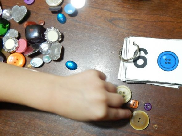 child counting buttons
