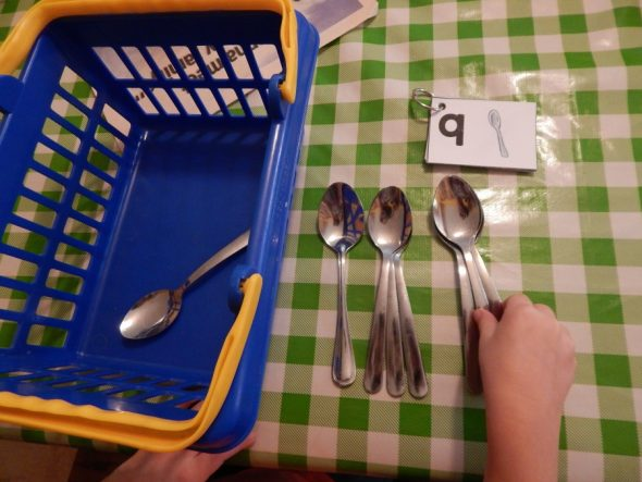 child counting spoons