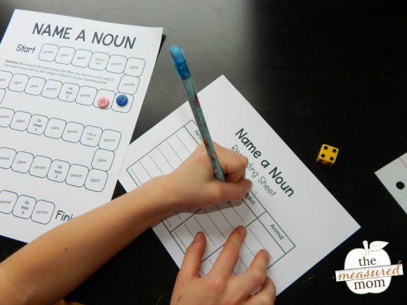 child playing a printable noun game