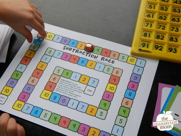 child playing subtraction game