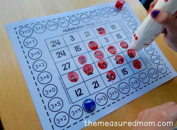 child dotting with do-a-dot marker on game